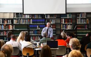 Faculty participate in a workshop on learning differences with neuropsychologist Rick Solomon