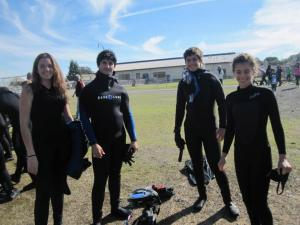 Students preparing to swim with salmon on an outing